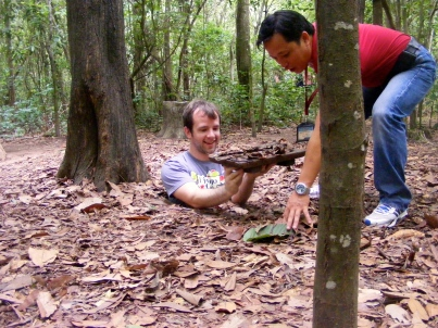 Craig explores the secret passageways at Cu Chi Tunnels