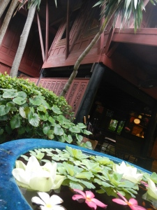 Floating water lilies flank the house